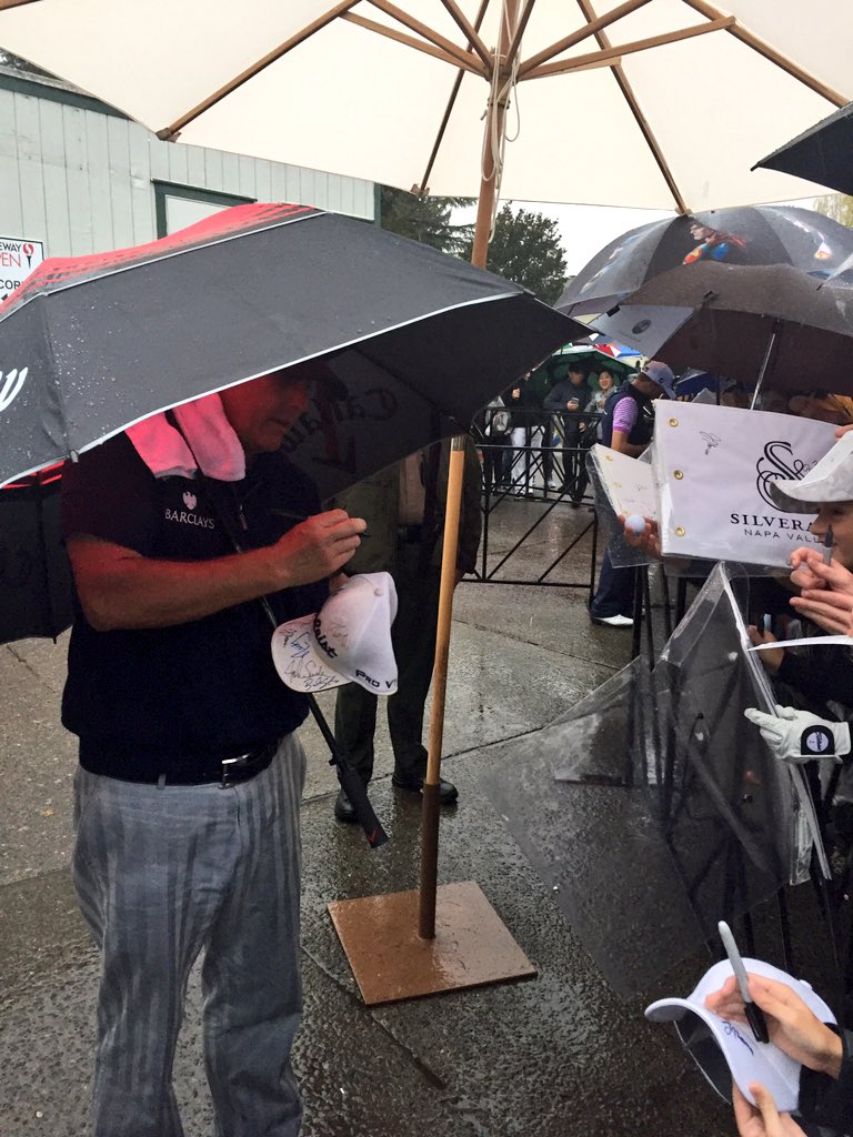 Phil Mickelson is still out here signing for everyone in the rain.