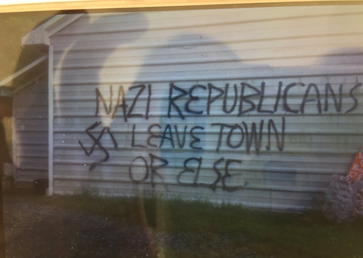"""Spray painted on the side of the OCGOP when it was fire bombed """"Nazi Republicans leave town or else"""" https://t.co/gvduwIpjMw"""