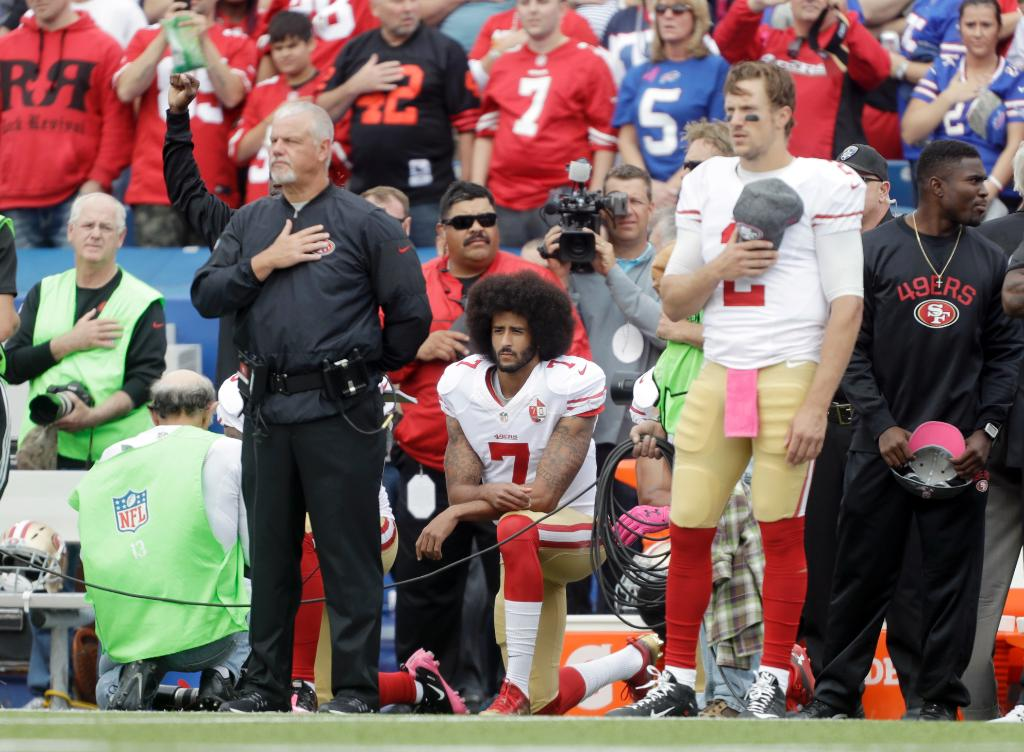 "Colin Kaepernick kneels for national anthem amid ""USA"" chants"