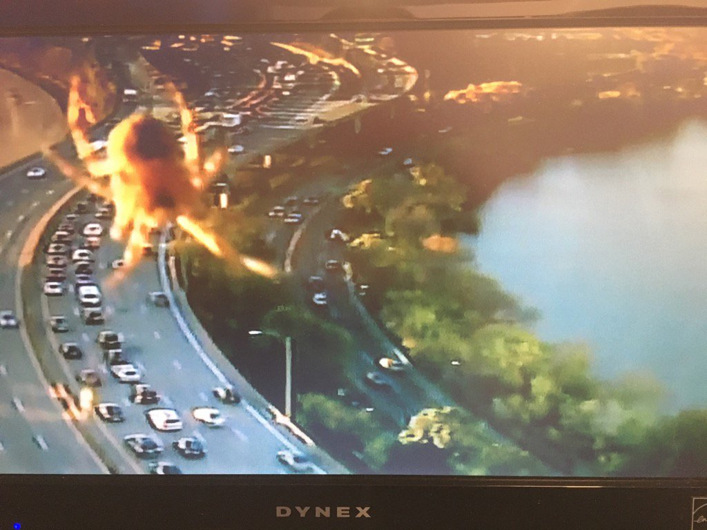 A giant spider causing delays on the Mass Pike. Two left lanes partially blocked.