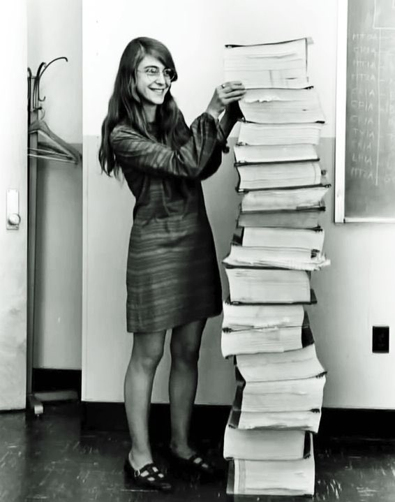 Margaret Hamilton next to the code she and her team wrote that made the moon landing possible #AdaLovelaceDay https://t.co/0Fot7cdI5P