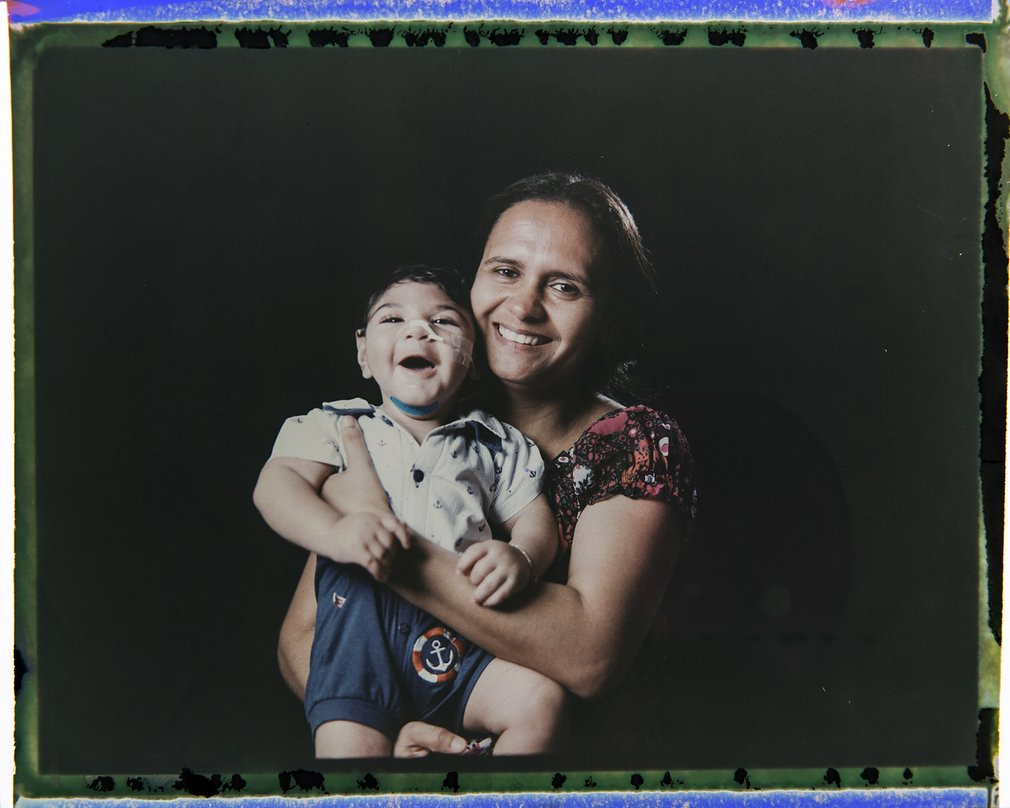 Portraits of families with babies disabled by Zika virus