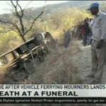 2 die after vehicle ferrying mourners lands in a ditch