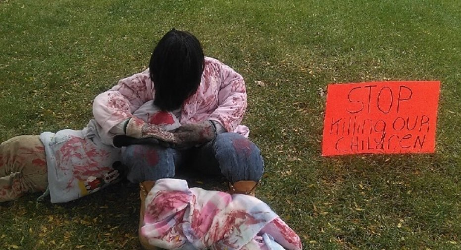 Why a Detroit grandma's Halloween display depicts police shootings and terrorist