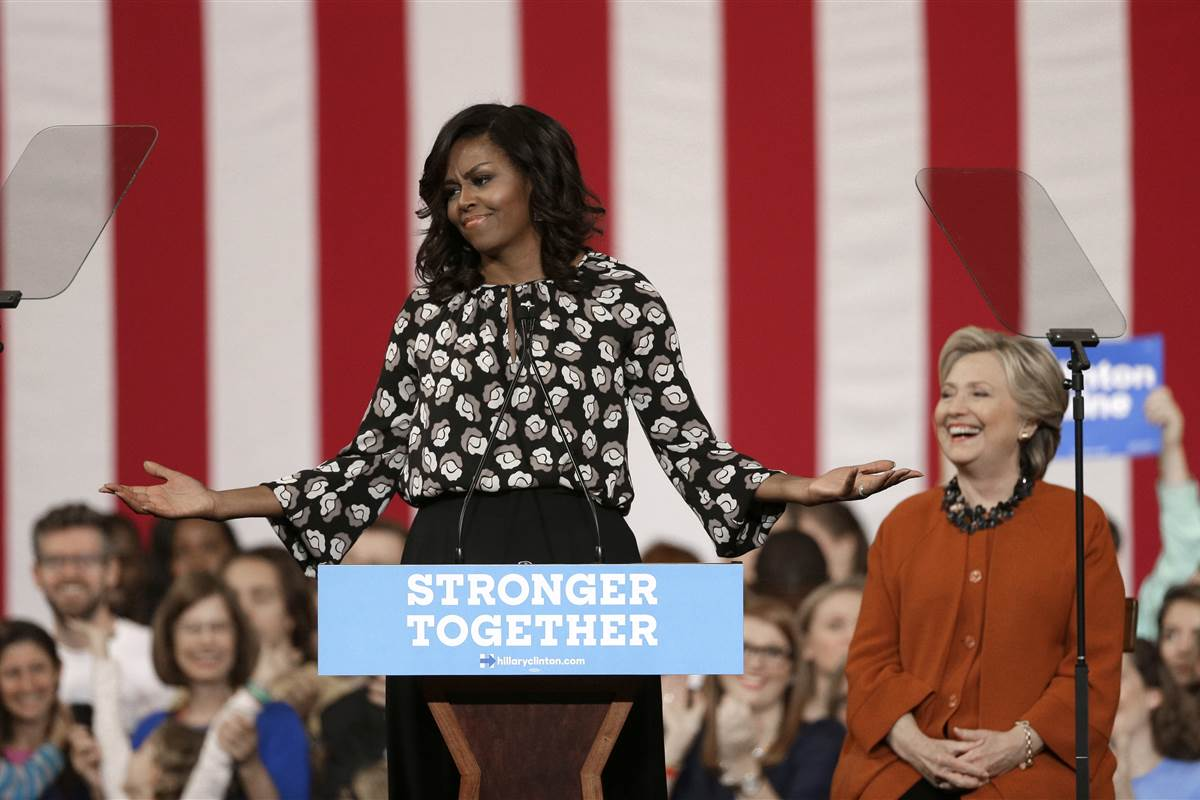 Clinton cedes the spotlight to fellow First Lady Michelle Obama