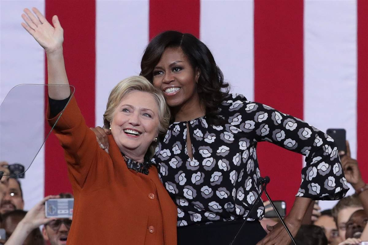 Hillary Clinton and Michelle Obama speak out against bullies at first joint rally
