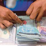 Ringgit opens lower against US dollar on lower oil prices