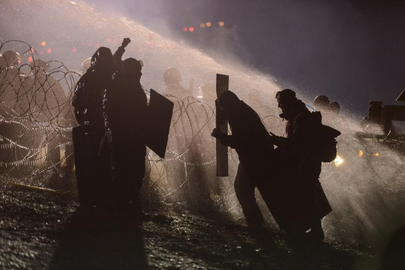 Police fire water cannon at Dakota pipeline protesters in freezing weather