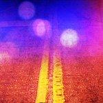 Teen dies in highway crash when car strikes parked pickup