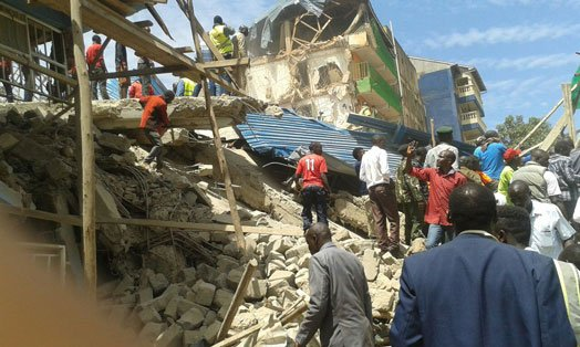 Owner of collapsed building surrenders to police
