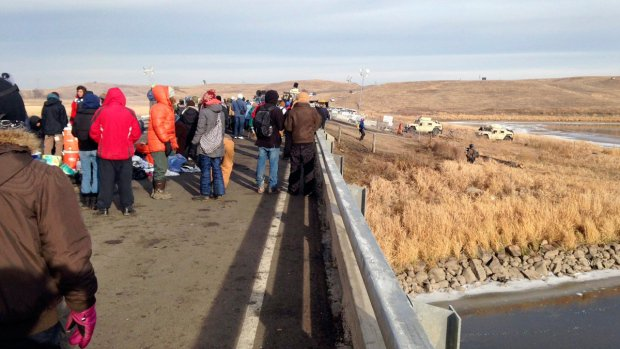 Officers douse Dakota Access oil pipeline protesters in subfreezing weather