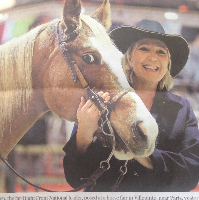 This horse did not sign up for a photo opportunity with Marine Le Pen, and he wants you to know it
