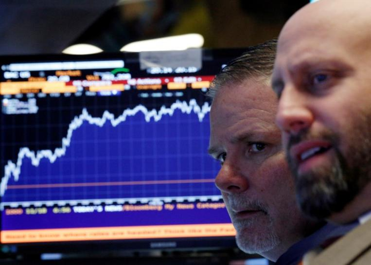 Wall St. inches up with health stocks; Nasdaq hits record