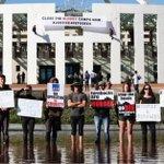 Australia parliament: Second dramatic protest over asylum