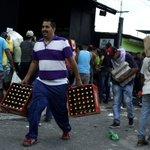 Venezuela delays removing currency bills amid crisis, protests