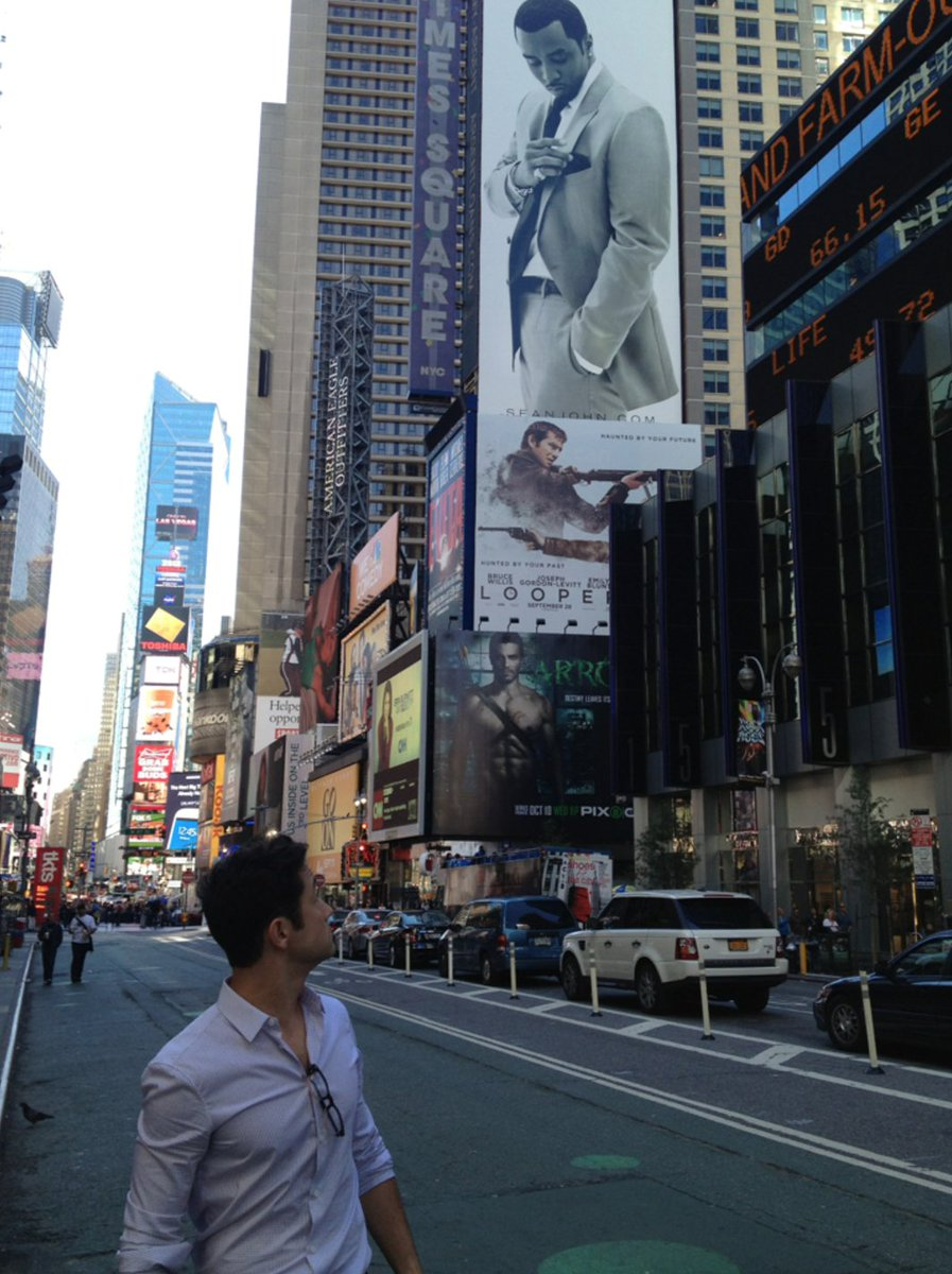 Big Puff watching over little Joe in Times Square. @Loopermovie #FBF https://t.co/4iQAHZEF3S