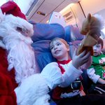 Children meet Santa on flight to North Pole