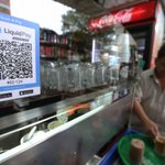 Lukewarm interest in new cashless payment systems at hawker centres
