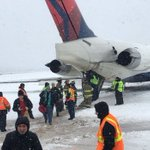 Delta Air Lines airplane slides off runway at snowy Detroit airport