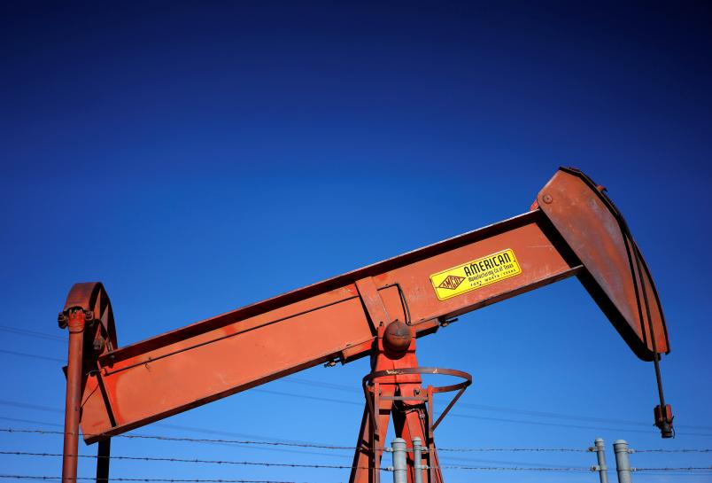 Oil prices fall on rising U.S. crude stocks, OPEC output concerns