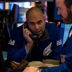 US stocks retreat as Fed hikes interest rates