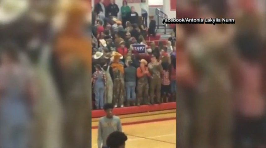 School officials apologize after white students turn their backs on black basketball players