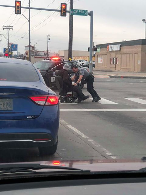 test Twitter Media - A grateful onlooker sent us these photos of Sgt. Holcomb helping a citizen along after his wheelchair lost power near SW 59th/Western. Great job Sgt. Holcomb! https://t.co/9UdNDizexx
