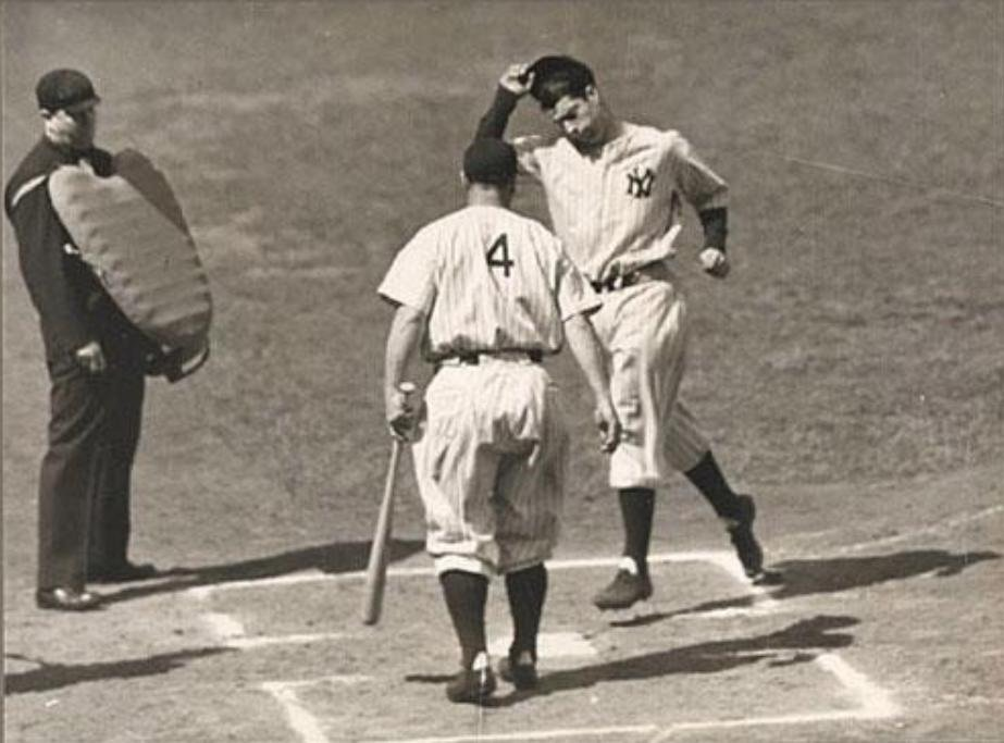 Yankee Stadium, May 10, 1936 - One Yankee Legend in Lou Gehrig greets a future Yankee Legend in rookie Joe DiMaggio who just hit his 1st career home run.The 2-run blast scoring Red Rolfe in the first was off A's hurler George Turbeville. Joe D finished his career with 361 homers https://t.co/ky6KBGvgPF