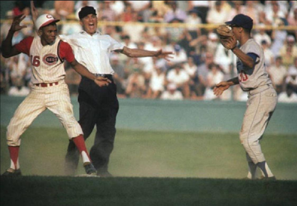 Crosley Field, Cincinnati, August 1961 - I don't know if Reds' Leo Cardenas and Dodgers' Maury Wills are in some sort of showdown and if some unknown umpire is either singing opera or making the call, what I do know is this image is from the camera of the legendary Neil Leifer https://t.co/BFRZGIsAqi