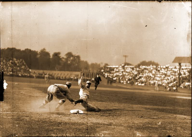 August 24, 1909: Tigers RF Ty Cobb is tagged out by Athletics 3B Frank Baker on an attempted steal of 3rd in the bottom of the 1st inning. Cobb gashed Barker's forearm during the play - heating up the intense rivalry.  Tigers 7, Athletics 6 Bennett Park, Detroit @OTBaseballPhoto https://t.co/NtMDD45giI