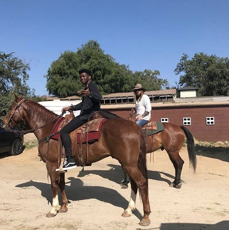 Here's a photo of Lil Nas X and Billy Ray Cyrus riding horses 🐎 https://t.co/u7dDHSFv3q
