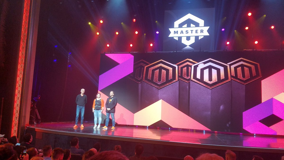 MissDestructo: Look at @sherrierohde and @benmarks rocking it up on stage introducing the @magento Masters! #MagentoImagine https://t.co/R80c6gFdR0