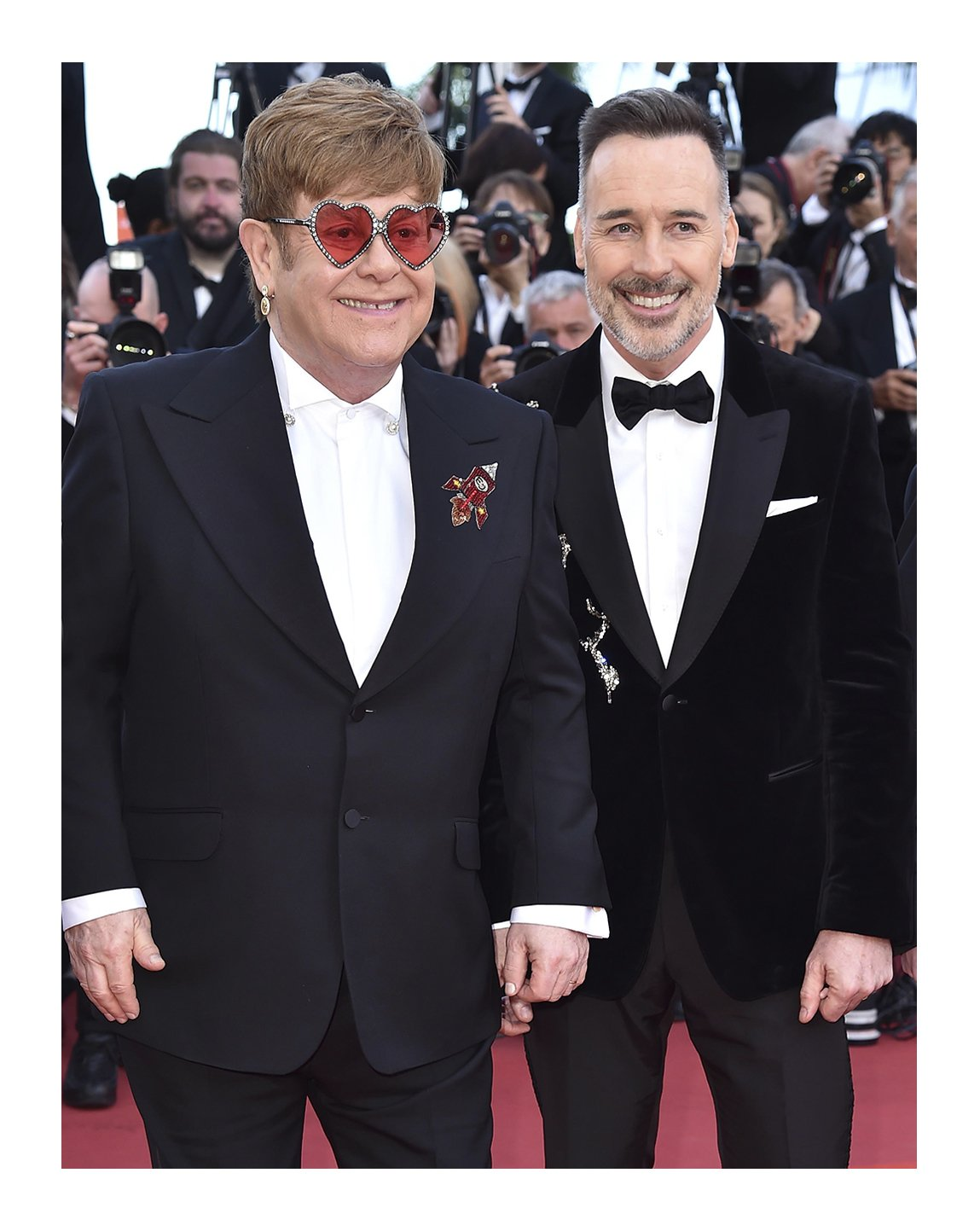 To the @rocketmanmovie's premiere at @festivaldecannes, Sir @eltonofficial and #DavidFurnish. Interpreted by @TaronEgerton, the musical fantasy about the incredible human story of #EltonJohn's breakthrough years features looks by #AlessandroMichele. #Cannes2019  #NeverOrdinary https://t.co/pquyKaPWRf