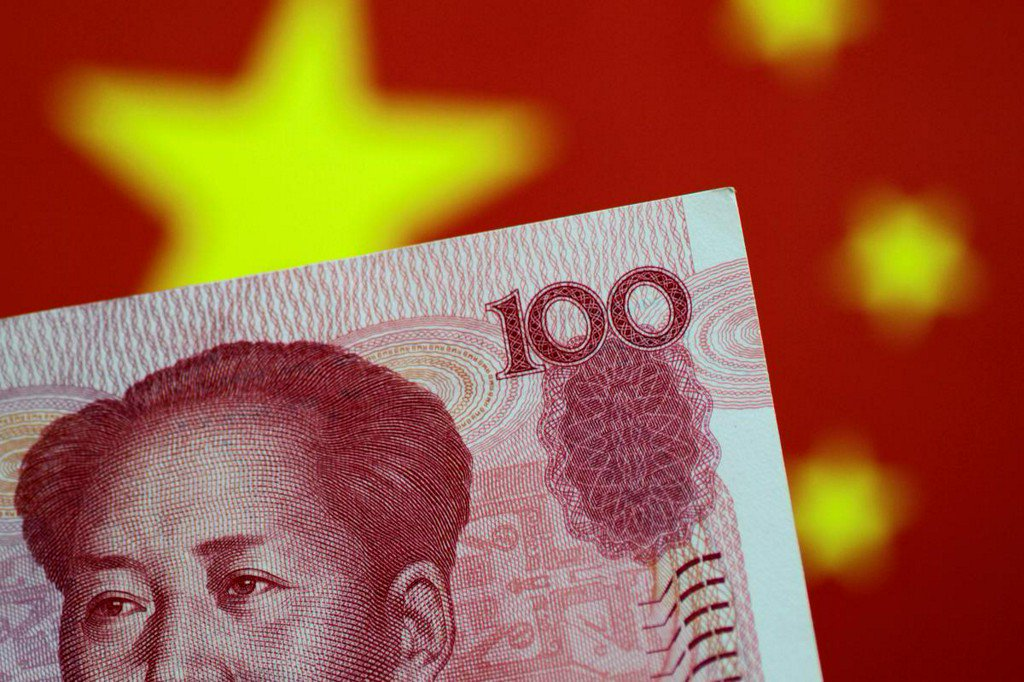China's top banking regulator says yuan bears will suffer 'heavy losses'