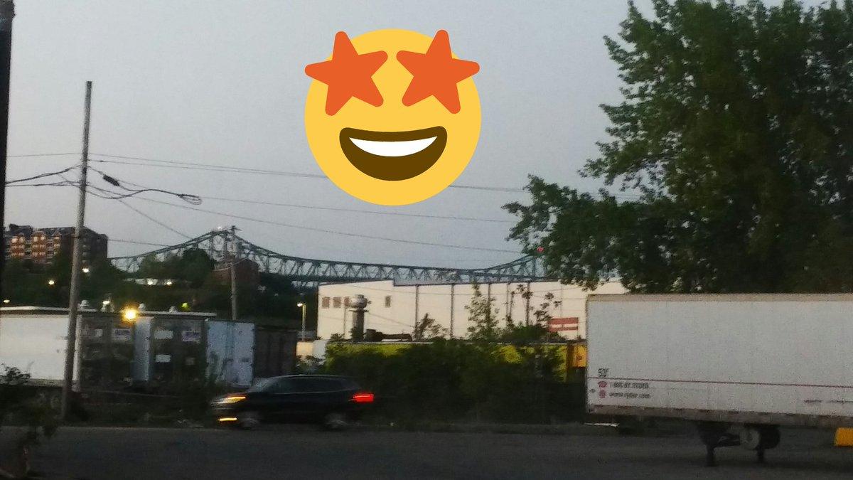 Dawn is breaking over Boston's Tobin Bridge, as seen from some random Memorial Day Weekend banana warehouse: https://t.co/vdrErgJWiw