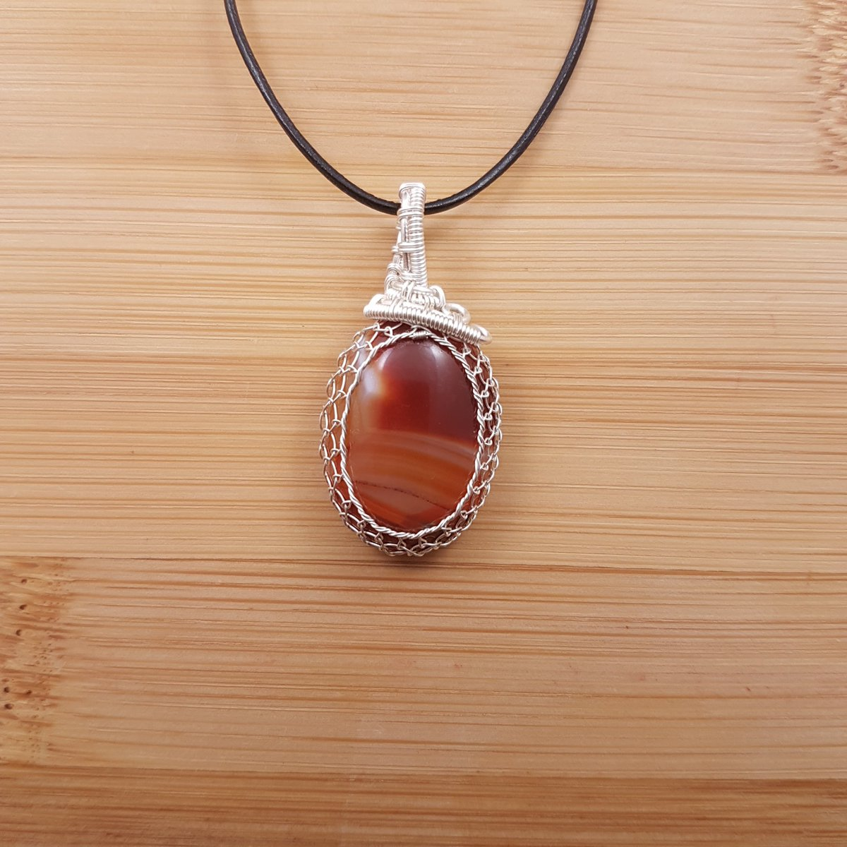 Orange Brazilian agate oval pendant wrapped in silver wire | Etsy