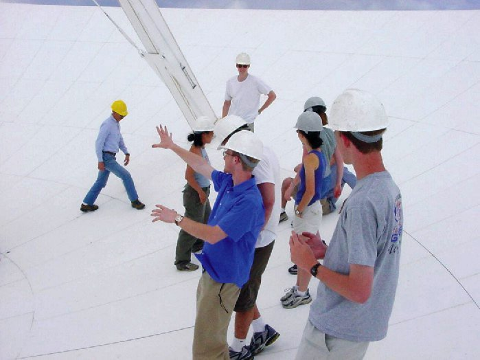 Our summer students have arrived, and they're getting ready for a busy summer! Since the beginning of our program in 1959, we've worked with over 1,200 students helping them to develop research projects. In this 2001 photo, students are standing on the surface of a #VLA antenna. https://t.co/iUvXvyj5PS