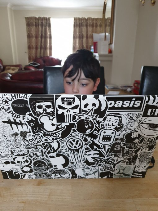 "Happy birthday Maxwell.. loving his new laptop, shush""dads old one but with stickers on ha ha\"""