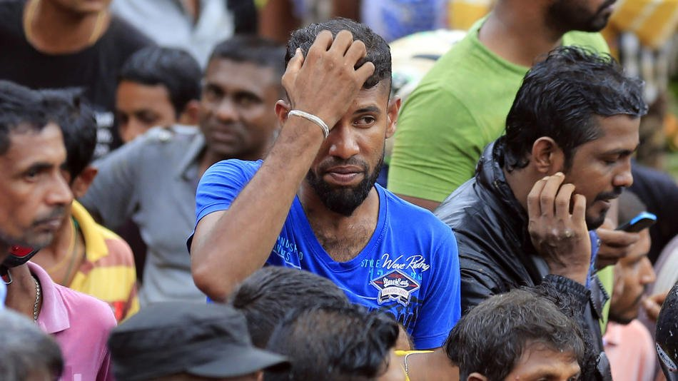 Sri Lanka pleads for help as the death toll from floods and mudslides hits 100