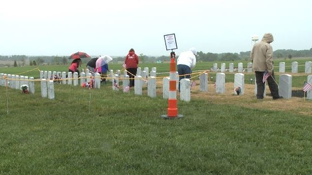Volunteers prepare for Memorial Day ceremony at Omaha National Cemetery