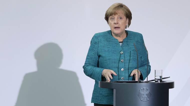 German leaders court migrants from Russia ahead ofelection