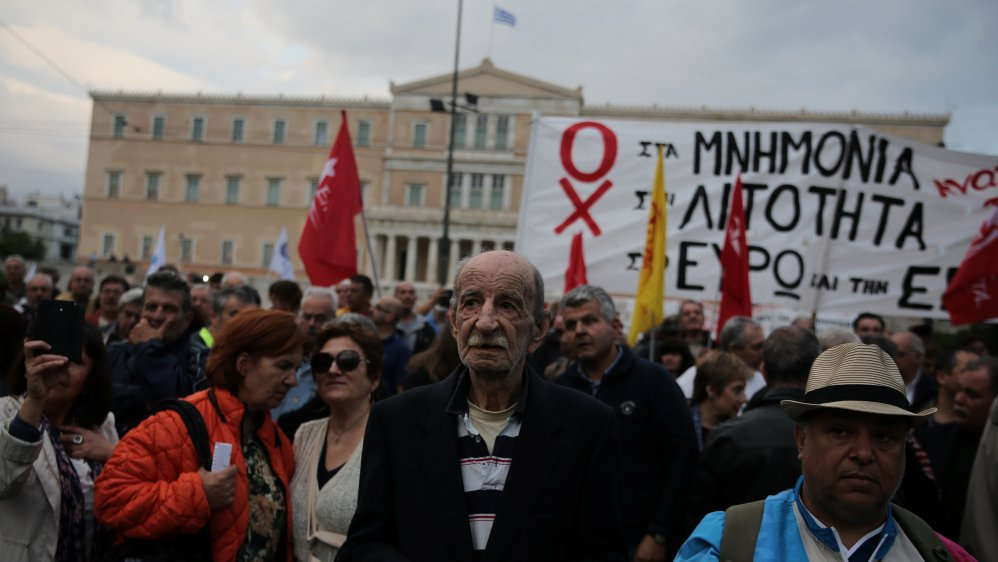 Thousands rally in Greece as MPs approve more austerity to unlock bailout