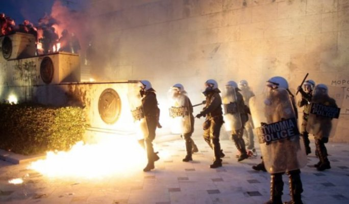 Greece adopts more austerity measures in bailout bid amidst violent protests