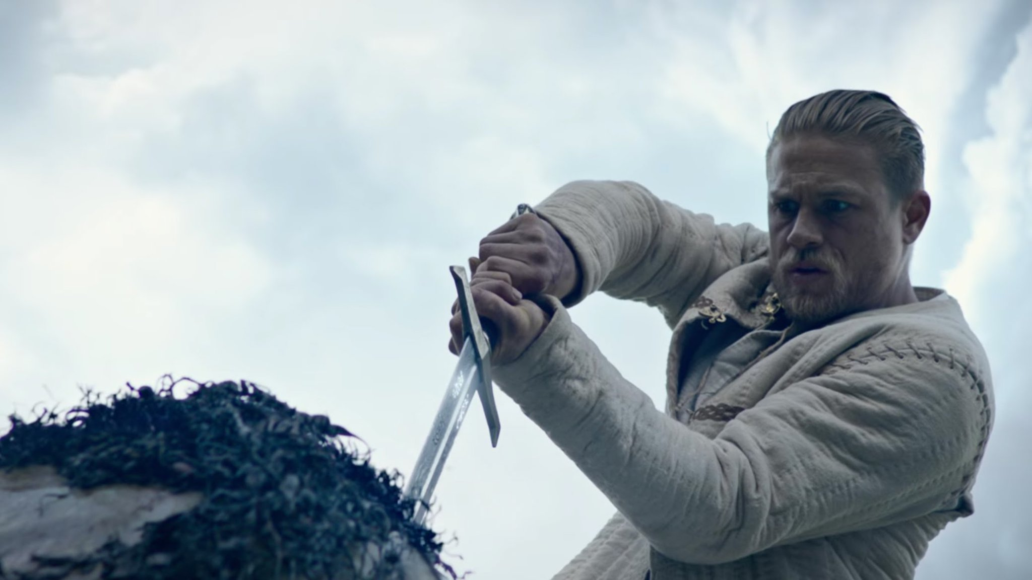 'King Arthur: Legend Of The Sword' (out today) is a laddy and loud fantasy romp. Our review: https://t.co/RuYbur56Hu https://t.co/q0FqFxTKYG