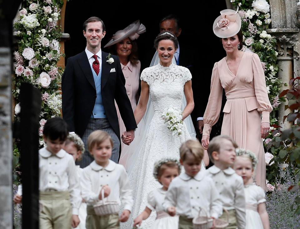 First look at the stunning displays of white roses and pink peonies that decorated the quaint local church where Pippa got hitched