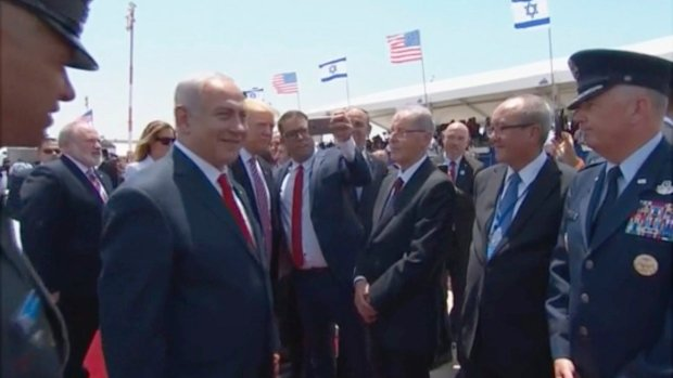 Trump greeted with selfies and politics on arrival in Israel