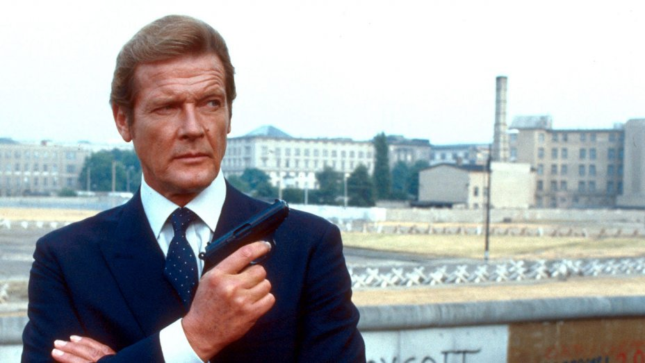 "Roger Moore played James Bond in 7 films with a ""cartoonish, cheeky charm"""