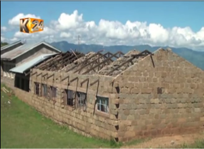 Students forced to study under a tree after strong wind blew off the schools roofing