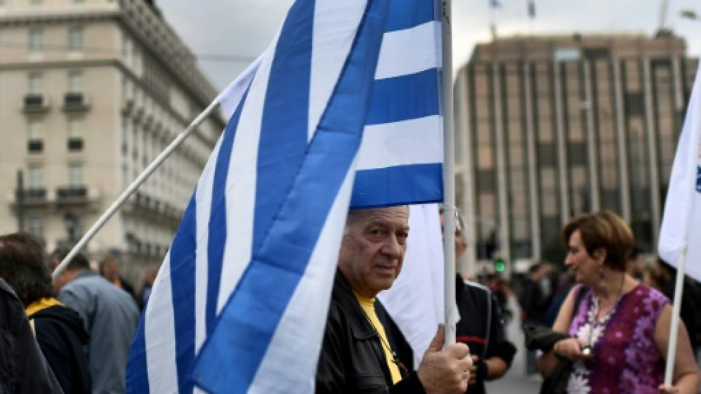 Greece says vital loan payment not affected by debt talks impasse