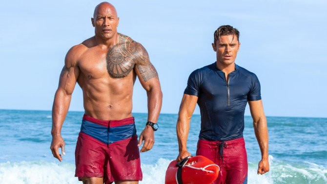 "Film Review: @TheRock and @ZacEfron's Baywatch is ""stupidly entertaining... for a while."""